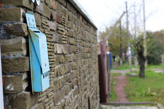 Mailbox on a brick wall Stock Photo