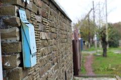 Mailbox on a brick wall Stock Photo