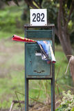 A mailbox with in the brochures of supermarkets. Blurred background. Royalty Free Stock Image