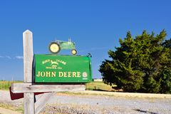 Mailbox with the colors and brand of John Deere. Royalty Free Stock Photos