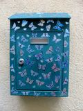 Mailbox decorated with butterfly patterns Stock Images