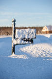 Mailbox deep in snow. Green mailbox buried in deep snow by covered road stock images