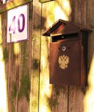 Mailbox with a double-headed eagle of the Russian Federation. stock photography