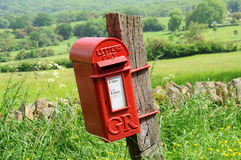 Mailbox in English countryside of Cotswolds. Od mailbox hanging on wood in English countryside of Cotswolds Stock Images
