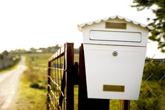 Mailbox on a fence Stock Photography