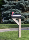 Mailbox with flag raised Royalty Free Stock Image