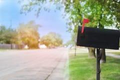 Mailbox with flag up in suburban neighborhood Royalty Free Stock Photos