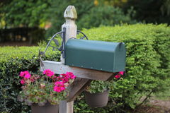 Mailbox with flower pot Stock Photo