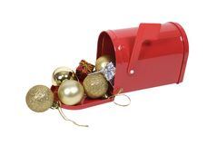 Mailbox full of cheer. Red metal mailbox with signal flag full of Christmas cheer - path included Royalty Free Stock Photos