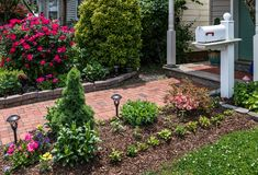 Mailbox in Garden Stock Image