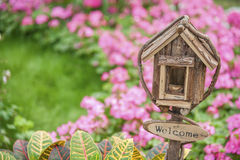 Mailbox in garden. Ornate Mailbox with welcome sign in colorful garden stock photos