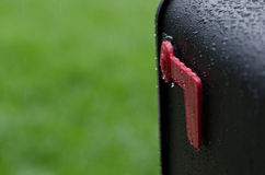 Mailbox. A image of a usps approved mail box with the flag down on a rainy day Stock Photos