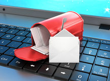 Mailbox on the keyboard, open letter on the keyboard. Stock Photo