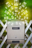 Mailbox with letter icons on glowing green background Royalty Free Stock Photo