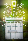 Mailbox with letter icons on glowing green background Stock Photography