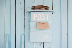 Mailbox with letters in vintage style on wooden blue background Royalty Free Stock Image