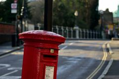 Mailbox in London. Mailbox, a bridge in the background. January sunshine in London. 01 16 2018 Stock Image