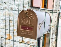 Mailbox mounted on the house gate stock photos