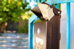 Mailbox with newspaper Stock Images