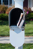 Mailbox with newspaper and letters Royalty Free Stock Photos