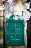 Mailbox with daily newspapers flying Stock Photography