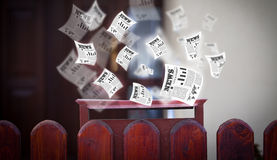 Mailbox with daily newspapers flying Royalty Free Stock Image