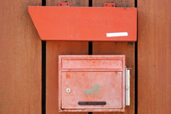 Mailbox and newspapers put Royalty Free Stock Image