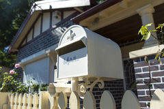 Mailbox. A nice clean and new mailbox at the front of a suburban house with the shutters down. Copyspace Stock Photography