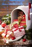 Mailbox overflowing with Christmas gifts royalty free stock images