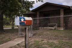 Mailbox painted with the Texas Flag in fron of a house in Texas, USA. Concept for travel in Texas stock photos