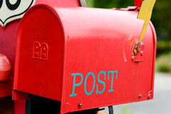 A mailbox. A red mailbox in front of some house Stock Image