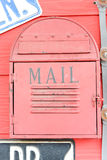 A mailbox. A red mailbox in front of some house Stock Images