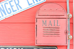 A mailbox. A red mailbox in front of some house Stock Photos