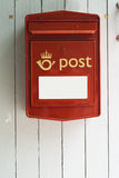 Mailbox. Red Norwegian mailbox on white wooden facade Stock Photography