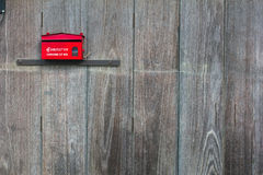 Mailbox. Red mailbox on old wooden wall Royalty Free Stock Photos