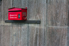 Mailbox. Red mailbox on old wooden wall Stock Photos
