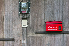 Mailbox. Red mailbox on old wooden wall Stock Photo