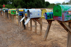 Mailbox Row. Painted mailboxes along rural road in New Mexico village Royalty Free Stock Photos