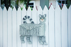 Mailbox shaped like a cat, white fence, palm, street art, Keys Royalty Free Stock Photography