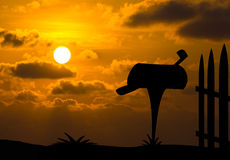 Mailbox silhouette with sunset background Stock Photos