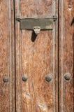 Mailbox slot in wooden door Royalty Free Stock Image