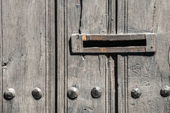 Mailbox slot in wooden door Royalty Free Stock Photos