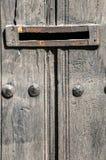Mailbox slot in wooden door Stock Photos