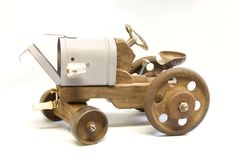 Mailbox on Wheels. A handmade tractor with iron wheels and mailbox Stock Photography