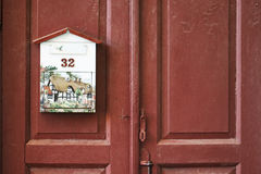 Mailbox on the wooden door. Royalty Free Stock Images