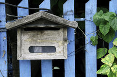 Mailbox. On a wooden fence Royalty Free Stock Image