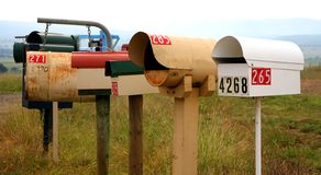 Mailboxes. Country mail boxes on lane Royalty Free Stock Photo