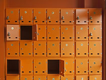 Mailboxes. Many orange mailboxes. Some of them opened Royalty Free Stock Image