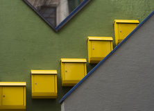 Mailboxes. Yellow mailboxes on a green wall Stock Images