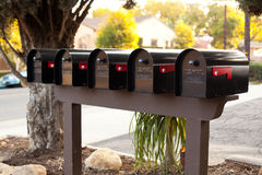 Mailboxes. Five black United States mailboxes on the street Stock Photography